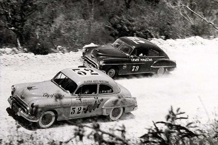 Hershel McGriff and Ray Elliott (car no. 52) in their Oldsmobile 88 on their way to win the rally